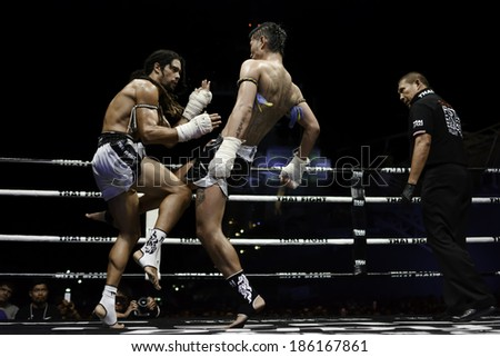SATTAHIP, THAILAND- APRIL 6 : Between the punch  in Thai Fight : Muay Thai..World's  between Sudsakorn Sor.Klinmee VS Cody Moberly on April 6, 2014 at King of muay thai , Chonburi , Thailand - stock photo