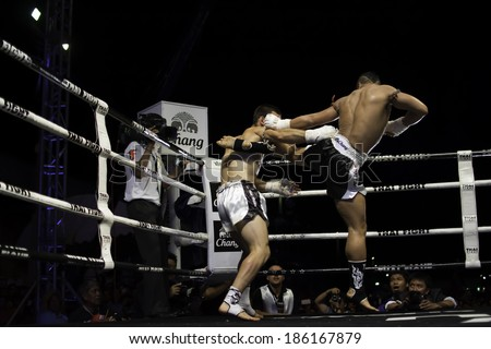SATTAHIP, THAILAND- APRIL 6 : Between the punch  in Thai Fight : Muay Thai..World's  between Yodsanklai Fairtex VS Diogo cAlado on April 6, 2014 at King of muay thai , Chonburi , Thailand - stock photo