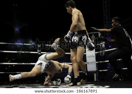 SATTAHIP, THAILAND- APRIL 6 : Between the punch  in Thai Fight : Muay Thai..World's  between Antoine Pinto (France) VS Alan Ryan (Scotland)  on April 6, 2014 at King of muay thai , Chonburi , Thailand - stock photo