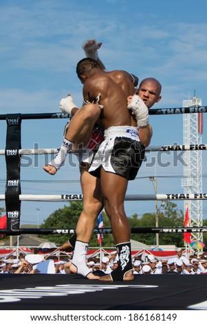 SATTAHIP, THAILAND- APRIL 6 : Between the punch  in Thai Fight : Muay Thai..World's  between Sueadam khongsittha Muay Thai VS Christophe TarTari on  April 6, 2014 , Chonburi , Thailand - stock photo