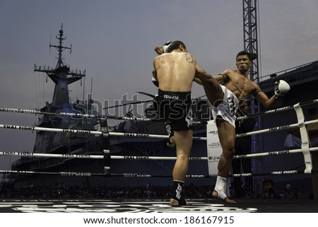 SATTAHIP, THAILAND- APRIL 6 : Between the punch  in Thai Fight : Muay Thai..World's  between Saiyok Pumpanmuang VS Chanajon P.K.Sanchai Muay Thai Gym on April 6, 2014 , Chonburi , Thailand - stock photo