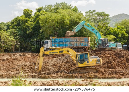 SATTAHIP , THAILAND - JULY 25, 2015 : Backhoe on the construction at digging the pit. Preparatory work for the construction. The work of construction machinery in a quarry , Thailand on July 25, 2015 - stock photo