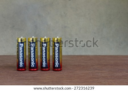 Saturday, 25 April 2015 : in Chiangmai Thailand , Panasonic Alkaline Battery on wood table and vintage background. - stock photo