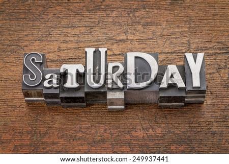 Saturday  word in mixed vintage metal type printing blocks over grunge wood - stock photo