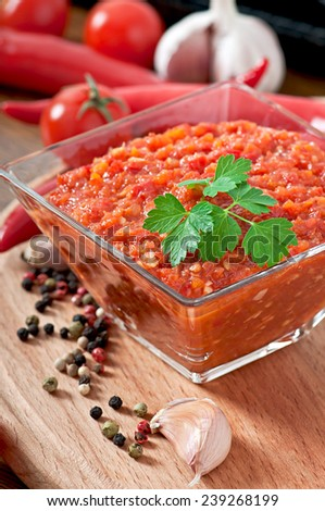 Sauce and red hot chili pepper and ingredients for sauce - stock photo
