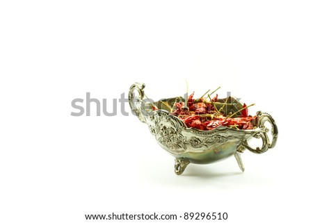 Sauce-boat with dried red chilli pepper isolated on white background