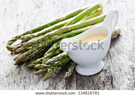 sauce hollandaise and asparagus - stock photo