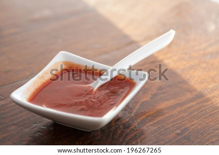 Sauce in small bowl on a table - stock photo