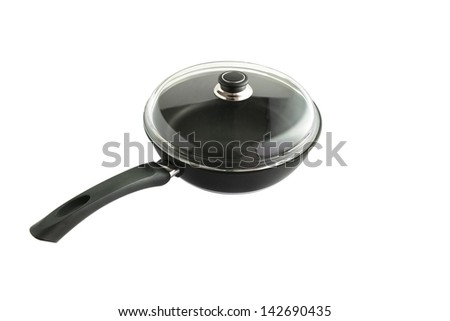 Saucepan covered by glass lid - stock photo