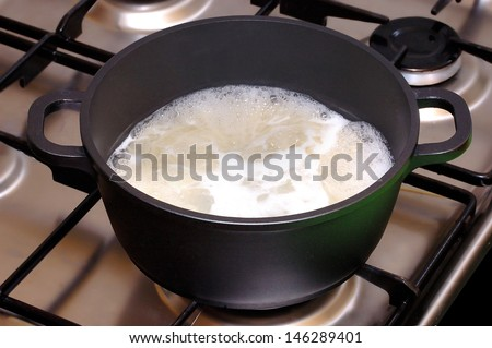 Saucepan with boiling food stand - stock photo