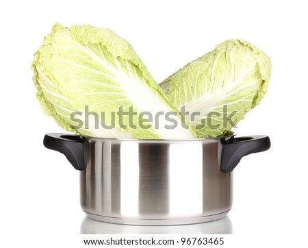 Saucepan with cabbages isolated on white