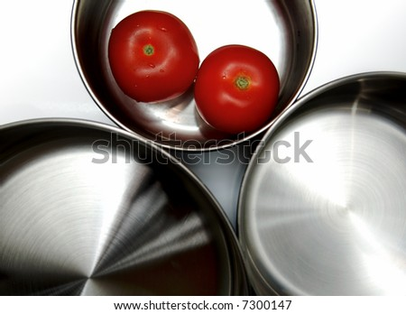 saucepans isolated with fresh vegetables inside - stock photo