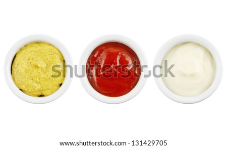 Sauces in bowls isolated on white with mustard, ketchup and mayonnaise