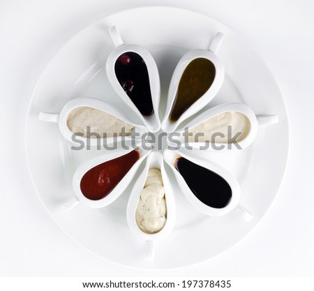 sauces in ceramic bowls - stock photo