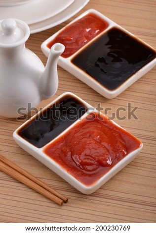 Sauces on the table , oyster sauce and tomato sauce  - stock photo
