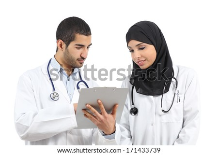 Saudi arab doctors diagnosing looking a medical history isolated on a white background               - stock photo