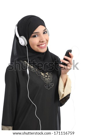 Saudi arab woman listening to the music from a smart phone and looking at camera isolated on a white background           - stock photo
