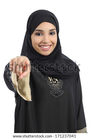 Saudi arab woman pointing at you and looking at camera isolated on a white background                - stock photo
