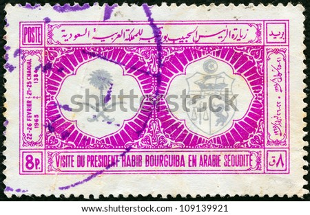 SAUDI ARABIA - CIRCA 1965: A stamp printed in Saudi Arabia issued for the visit of President Habib Bourguiba of Tunisia shows Arms of Saudi Arabia and Tunisia, circa 1965. - stock photo