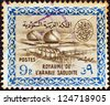 SAUDI ARABIA - CIRCA 1960: A stamp printed in Saudi Arabia shows Gas Oil Plant Cartouche of King Saud, circa 1960. - stock photo