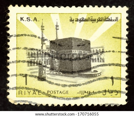 SAUDI ARABIA - CIRCA 1982: Yellow color stamp printed in Saudi Arabia with image of the holy Islamic Kaaba in Mecca. - stock photo
