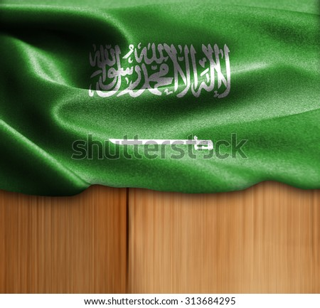 Saudi Arabia flag on wood Texture - stock photo