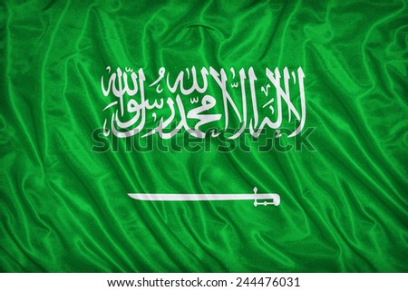 Saudi Arabia flag pattern on the fabric texture ,vintage style - stock photo