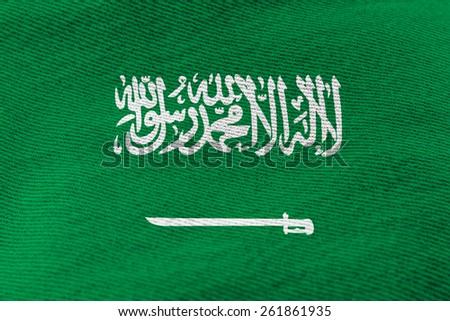 Saudi Arabia flag pattern on the fabric texture ,vintage style - stock photo