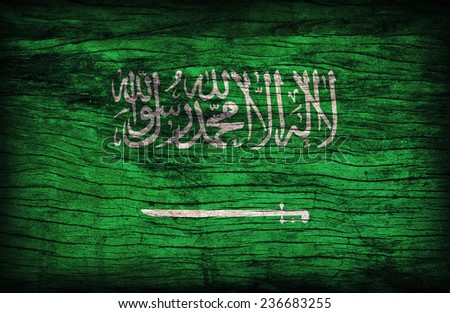 Saudi Arabia flag pattern on the wooden board texture ,retro vintage style - stock photo
