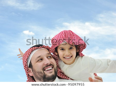 Saudi father and his little boy on shoulders - stock photo