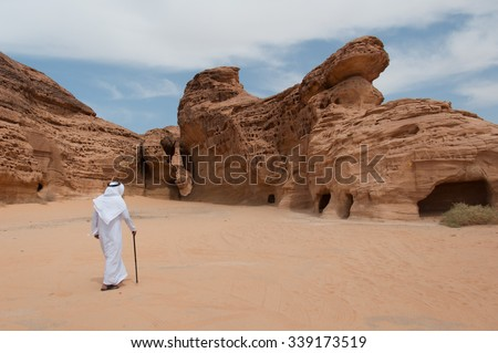Saudian walking in Madain Saleh archeological site, Saudi Arabia. - stock photo