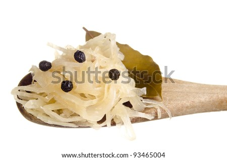 Sauerkraut and bay leaf on a wooden spoon - stock photo