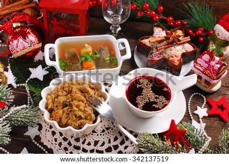 sauerkraut with mushrooms,carp in jelly,red borscht and dried fruit cake for traditional polish christmas eve supper