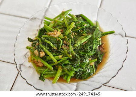 Saueted Japanese spinach on the plate