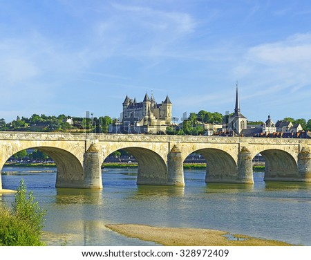 Saumur castle and river Loire, France. The Loire Valley with its castles is UNESCO World Heritage Site - stock photo