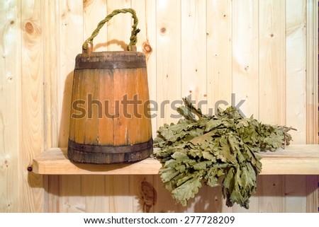 Sauna Accessories: vihta and bucket - stock photo