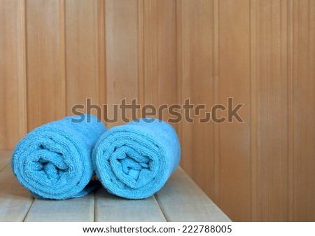 Sauna interior with green towels, leaving room for typing. - stock photo