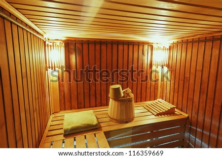 Sauna ready accessories - broom, tub, poltenets and scoop - stock photo
