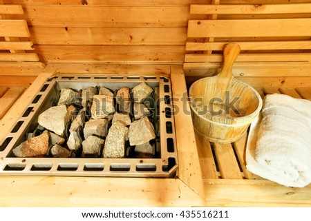 Sauna room with traditional sauna accessories.Healthy life style. - stock photo