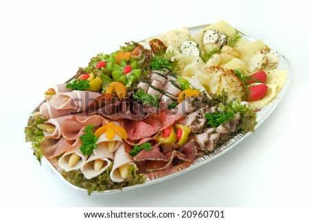 Sausage and cheese dish with vegetables. - stock photo