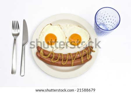 Sausage and eggs in happy breakfast - stock photo