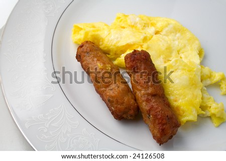 Sausage and eggs on plate