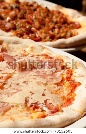 Sausage and ham pizza on a plate