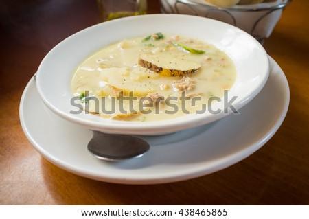 Sausage and kale zuppa toscana italian creamy soup - stock photo