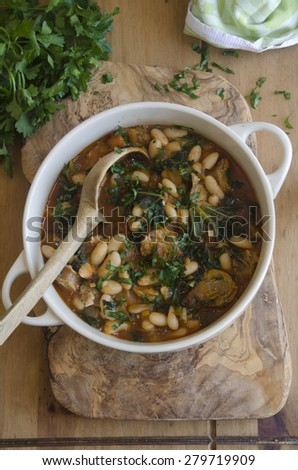Sausage, bean and kale stew - stock photo