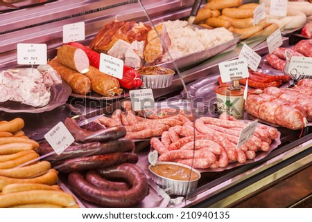 sausage display of a butcher - stock photo