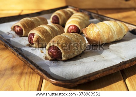Sausage dough on a wood background - stock photo