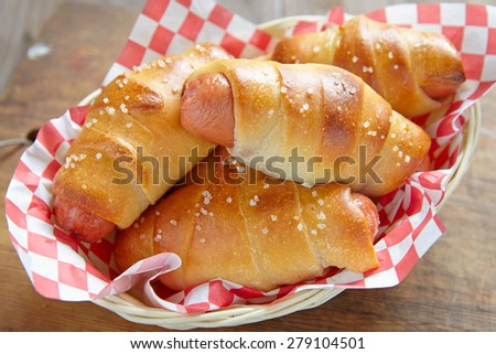 sausage in the dough for a picnic - stock photo