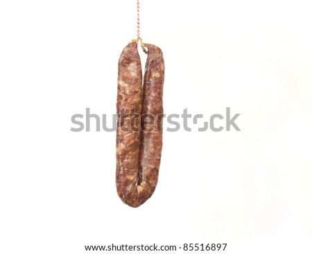 Sausage on a string symbolizing a Dutch proverb to lure someone with a sausage - stock photo