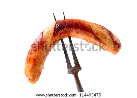 Sausage on fork fresh from grill. Isolated on white. - stock photo